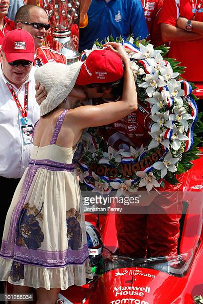 Dario Franchitti of Scotland driver of the Target Chip Ganassi Racing Dallara Honda celebrates with his wife Ashley Judd in victory lane after...