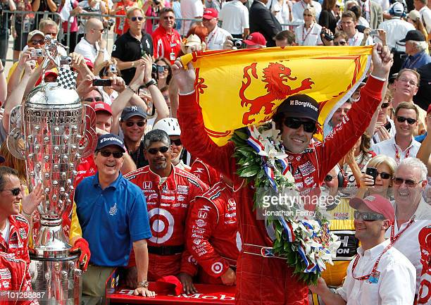 Dario Franchitti of Scotland driver of the Target Chip Ganassi Racing Dallara Honda celebrates in victory lane after winning the IZOD IndyCar Series...