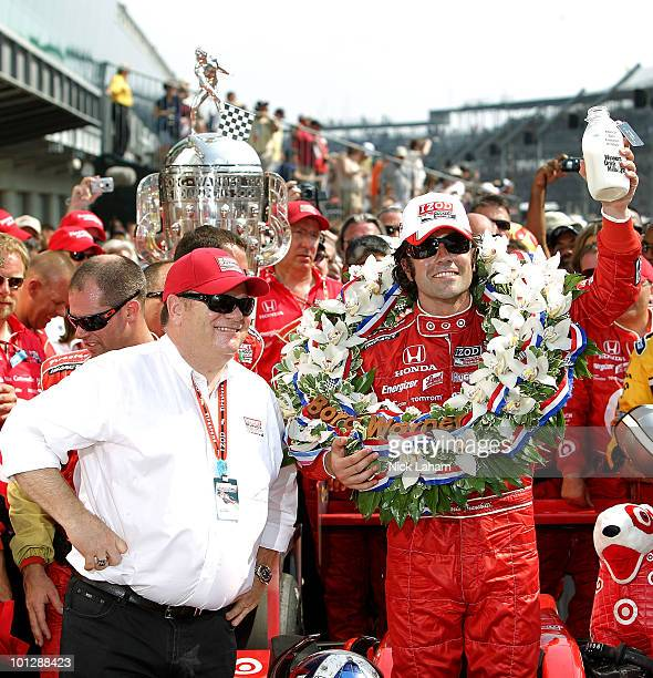 Dario Franchitti of Scotland driver of the Target Chip Ganassi Racing Dallara Honda celebrates with team owner Chip Ganassi in victory lane in...