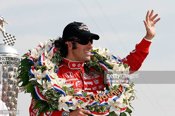 Dario Franchitti of Scotland driver of the Target Chip Ganassi Racing Dallara Honda celebrates in victory circle after winning the IZOD IndyCar...