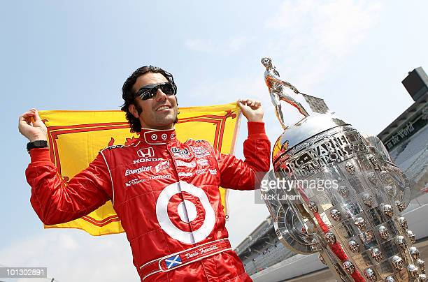 Dario Franchitti of Scotland driver of the Target Chip Ganassi Racing Dallara Honda poses with the Borg Warner trophy on the yard of brick during the...
