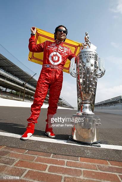 Dario Franchitti of Scotland driver of the Target Chip Ganassi Racing Dallara Honda poses with Borg Warner Trophy on the yard of bricks during the...