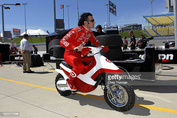 Dario Franchitti of Scotland driver of the Target Chip Ganassi Racing Dallara Honda rides his scooter following practice for the IRL Indycar Series...