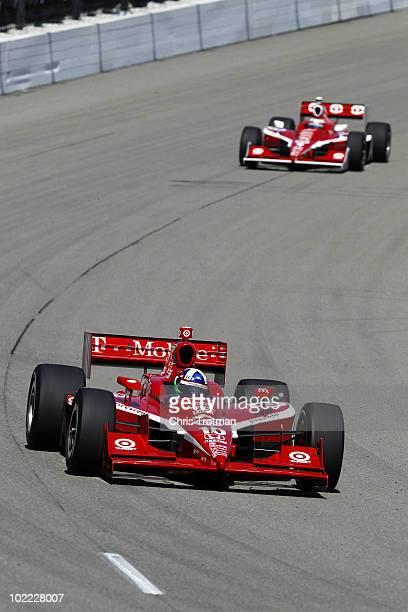 Dario Franchitti of Scotland driver of the Target Chip Ganassi Racing Dallara Honda leads teammate Scott Dixon of New Zealand driver of the Target...