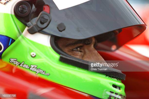Dario Franchitti of Scotland driver of the Target Chip Ganassi Racing Dallara Honda sets in his car during qualifying for the IRL Indycar Series Iowa...