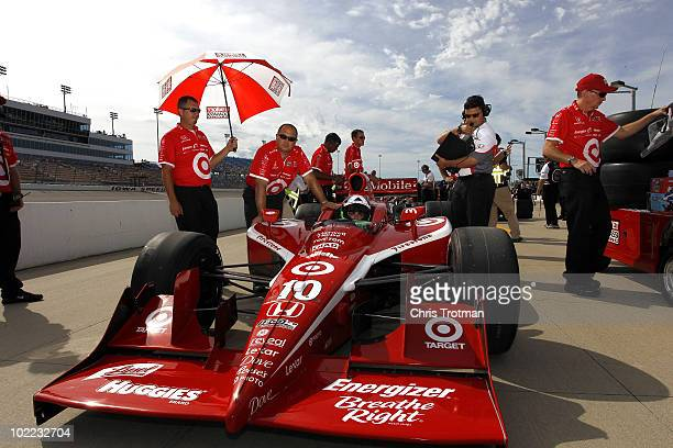 Dario Franchitti of Scotland driver of the Target Chip Ganassi Racing Dallara Honda sits in his car during qualifying for the IRL Indycar Series Iowa...
