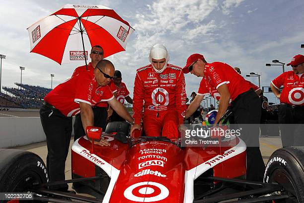 Dario Franchitti of Scotland driver of the Target Chip Ganassi Racing Dallara Honda gets into his car during qualifying for the IRL Indycar Series...