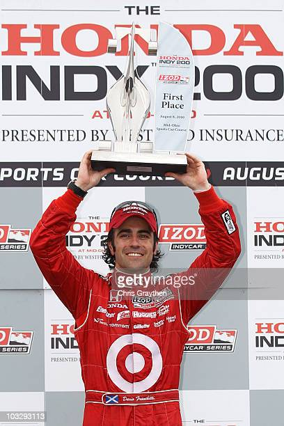 Dario Franchitti of Scotland driver of the Target Chip Ganassi Racing Dallara Honda celebrates after winning the IZOD IndyCar Series Honda Indy 200...
