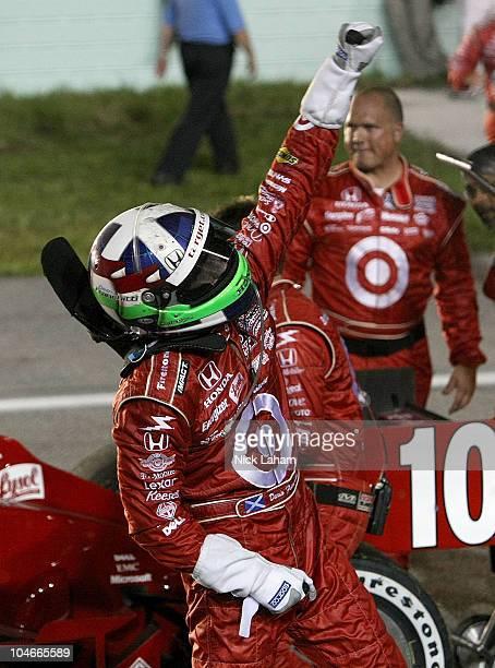 Dario Franchitti of Scotland driver of the Target Chip Ganassi Racing Dallara Honda celebrates winning the championship on the front straight during...