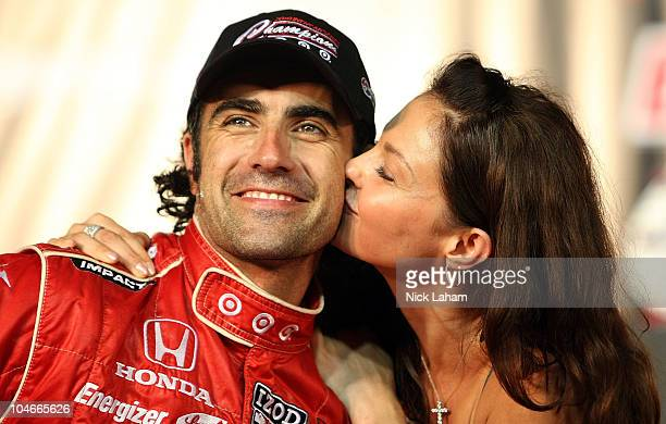 Dario Franchitti of Scotland driver of the Target Chip Ganassi Racing Dallara Honda celebrates winning the championship with wife Ashley Judd during...