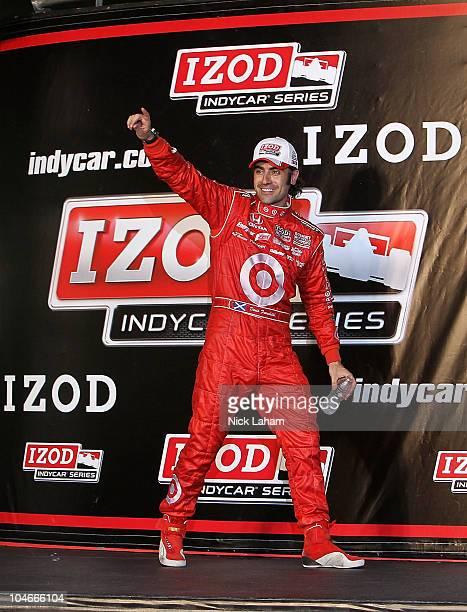 Dario Franchitti of Scotland driver of the Target Chip Ganassi Racing Dallara Honda celebrates winning the IndyCar Championship during the Cafes do...