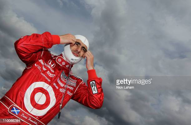 Dario Franchitti of Scotland driver of the Target Chip Ganassi Racing Dallara Honda in the pits during IZOD IndyCar Series Spring Training at Barber...