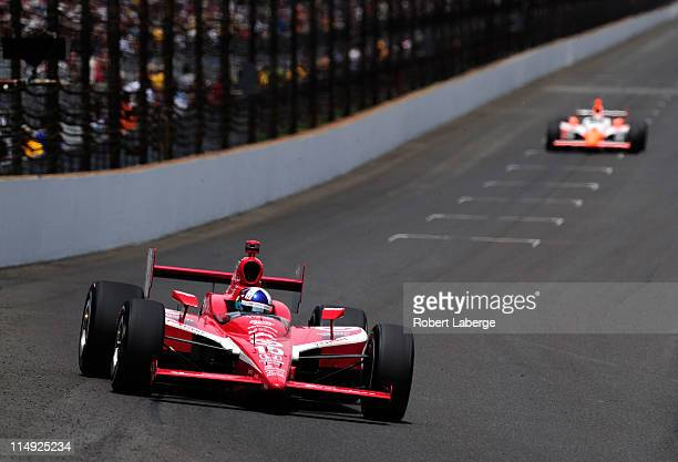 Dario Franchitti of Scotland driver of the Target Chip Ganassi Racing Dallara Honda races during the IZOD IndyCar Series Indianapolis 500 Mile Race...