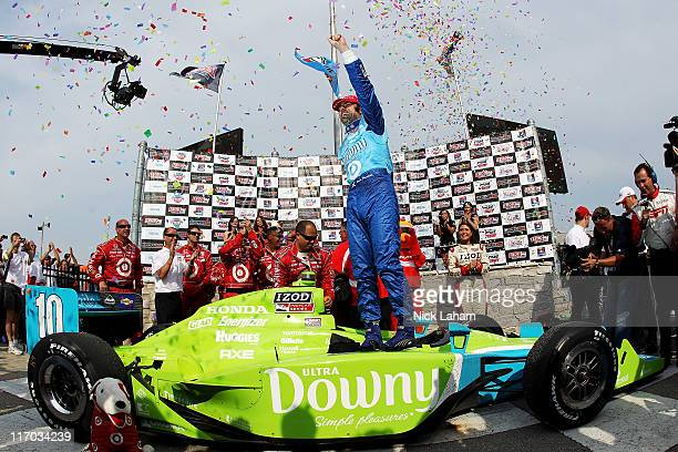 Dario Franchitti of Scotland driver of the Target Chip Ganassi Racing Downy Dallara Honda celebrates winning the IRL IndyCar Series Milwaukee 225 at...