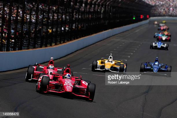 Dario Franchitti of Scotland driver of the Target Chip Ganassi Racing Honda leads teammate Scott Dixon of New Zealand driver of the Target Chip...