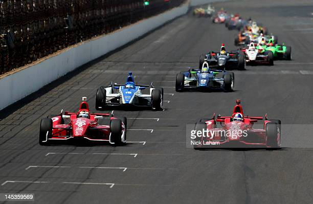 Dario Franchitti of Scotland driver of the Target Chip Ganassi Racing Honda gets ahead of teammate Scott Dixon of New Zealand driver of the Target...