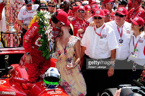 Dario Franchitti of Scotland driver of the Target Chip Ganassi Racing Honda kisses his wife Ashley Judd in victory lane in celebration of winning the...