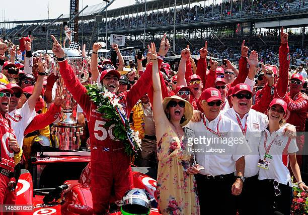 Dario Franchitti of Scotland driver of the Target Chip Ganassi Racing Honda celebrates in victory lane with his wife actress Ashley Judd team owner...