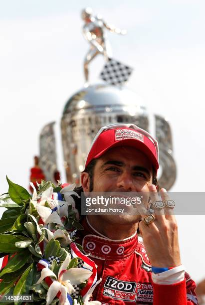 Dario Franchitti of Scotland driver of the Target Chip Ganassi Racing Honda Dallara DW12 celebrates winning this third Indy 500 after winning the...