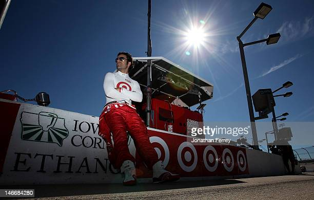 Dario Franchitti of Scotland driver of the Target Chip Ganassi Racing Honda Dallara sits on it wall prior to practice for the IZOD INDYCAR Series...