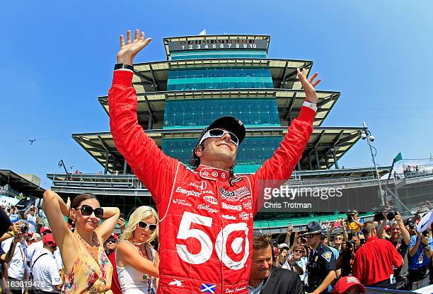 Dario Franchitti of Scotland driver of the Target Chip Ganassi Racing Honda celebrates wife Ashley Judd and Susie Wheldon wife of the late Dan...