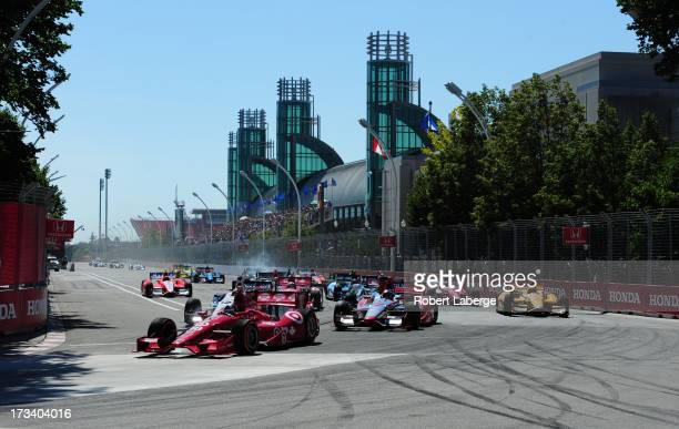 Dario Franchitti of Scotland driver of the Target Chip Ganassi Racing Honda Dallara leads at the start of race of the IZOD IndyCar Series Honda Indy...