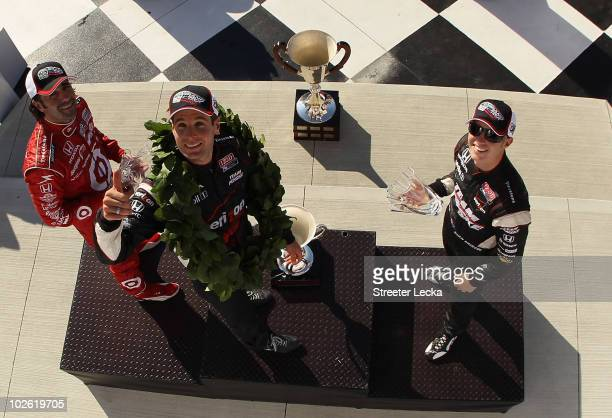 Dario Franchitti Will Power and Ryan Briscoe celebrate on the podium after the the IZOD IndyCar Series Camping World Grand Prix at the Glen at...