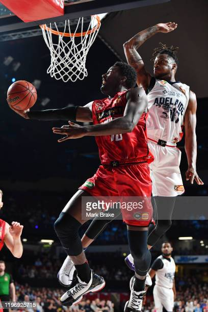 Dario Hunt of the Wildcats makes a basket defended by Eric Griffin of the 36ers during the round 13 NBL match between the Adelaide 36ers and the...