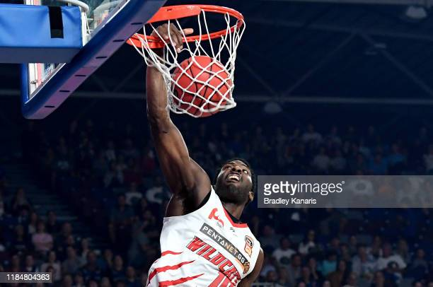 Dario Hunt of the Wildcats slam dunks during the round five NBL match between the Brisbane Bullets and the Perth Wildcats at Nissan Arena on November...
