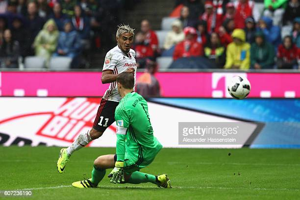 Dario Lazcano Farina of Ingolstadt scores the opening goal against Manuel Neuer keeper of Muenchen during the Bundesliga match between Bayern...