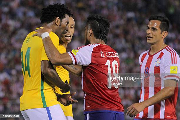 Dario Lezcano and Roque Santa Cruz of Paraguay argue with Gil and Miranda of Brazil during a match between Paraguay and Brazil as part of FIFA 2018...