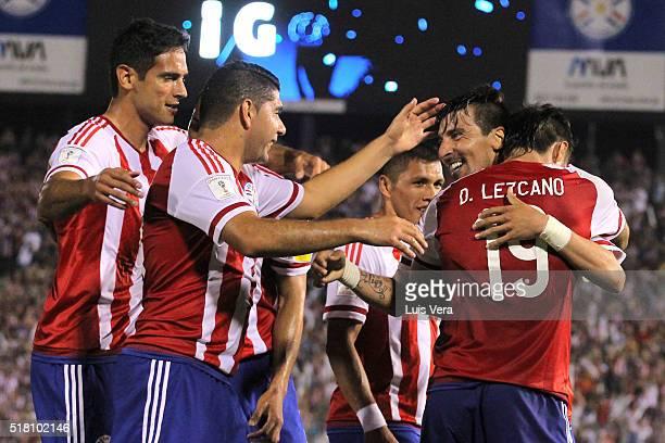 Dario Lezcano Edgar Benitez Nestor Ortigoza and Roque Santa Cruz of Paraguay celebrate a scoring goal during a match between Paraguay and Brazil as...
