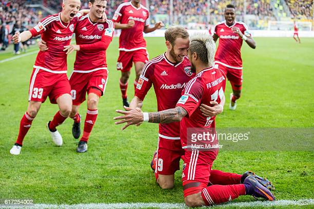 Dario Lezcano Farina and team members of FC Ingolstadt 04 celebrate the 31 goal during the Bundesliga match between FC Ingolstadt 04 and Borussia...