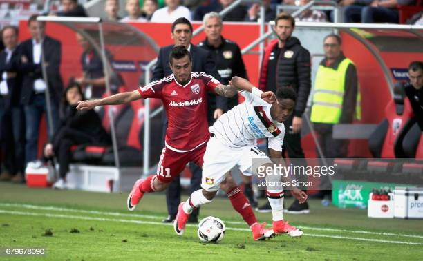 Dario Lezcano Farina of Ingolstadt and Wendell of Leverkusen fight for the ball during the Bundesliga match between FC Ingolstadt 04 and Bayer 04...