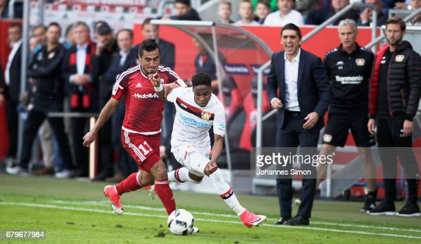 Dario Lezcano Farina of Ingolstadt and Wendell of Leverkusen watched by Korkut Tayfun head coach of Leverkusen fight for the ball during the...
