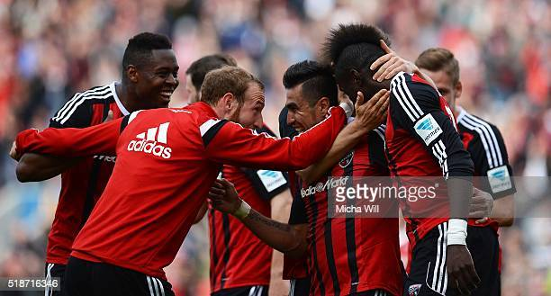 Dario Lezcano Farina of Ingolstadt celebrates with team-mates after scoring his team's third goal during the Bundesliga match between FC Ingolstadt...