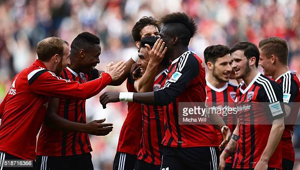 Dario Lezcano Farina of Ingolstadt celebrates with teammates after scoring his team's third goal during the Bundesliga match between FC Ingolstadt...