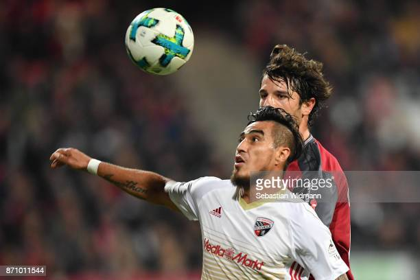Dario Lezcano of FC Ingolstadt 04 and Lukas Muehl  of 1FC Nuernberg compete for the ball during the Second Bundesliga match between 1 FC Nuernberg...