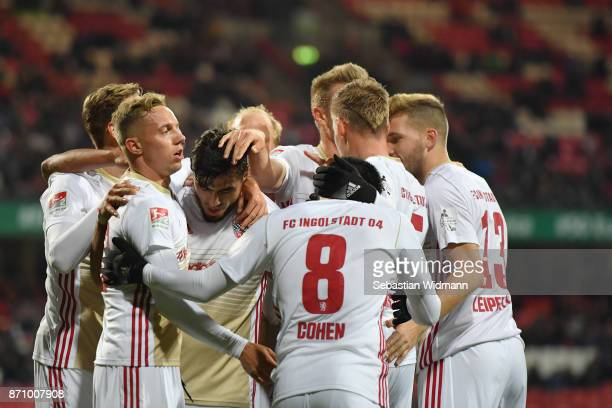 Dario Lezcano of FC Ingolstadt 04 celebrates with teammates scoring his teams second goal during the Second Bundesliga match between 1 FC Nuernberg...