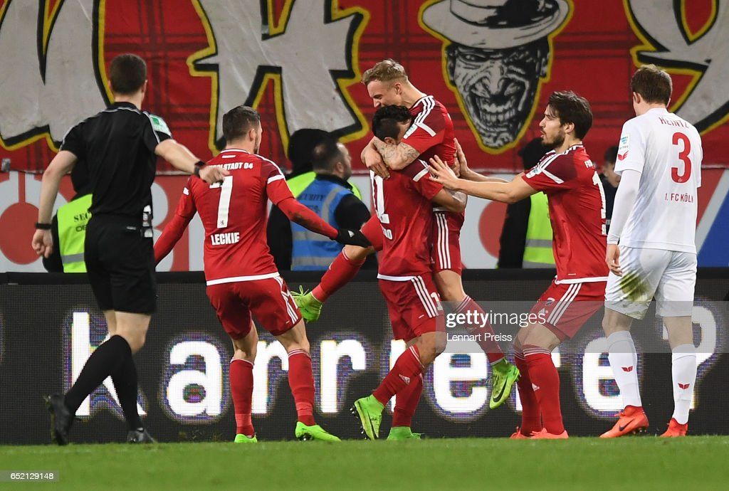 Dario Lezcano (C) of FC Ingolstadt and his teammates celebrate their first goal during the Bundesliga match between FC Ingolstadt 04 and 1. FC Koeln at Audi Sportpark on March 11, 2017 in Ingolstadt, Germany.