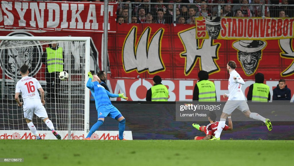 Dario Lezcano (2nd R) of FC Ingolstadt scores his side's first goal during the Bundesliga match between FC Ingolstadt 04 and 1. FC Koeln at Audi Sportpark on March 11, 2017 in Ingolstadt, Germany.