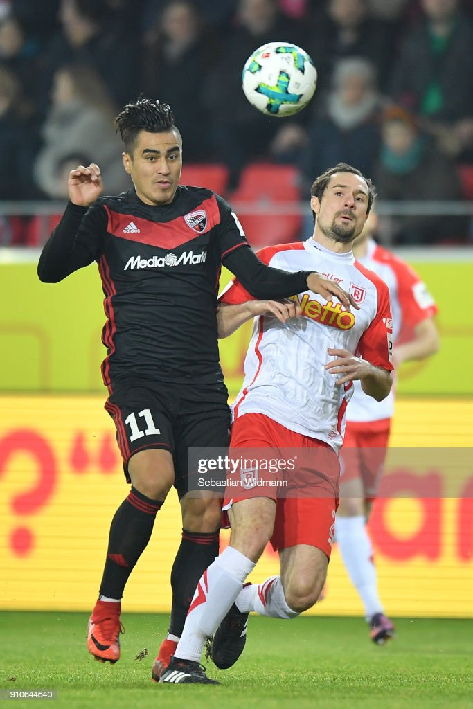 Dario Lezcano (l) of Ingolstadt and Sebastian Nachreiner of Regensburg compete for the ball during the Second Bundesliga match between SSV Jahn Regensburg and FC Ingolstadt 04 at Continental Arena on January 26, 2018 in Regensburg, Germany.