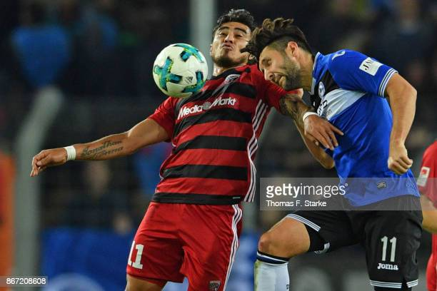 Dario Lezcano of Ingolstadt and Stephan Salger of Bielefeld head for the ball during the Second Bundesliga match between DSC Arminia Bielefeld and FC...