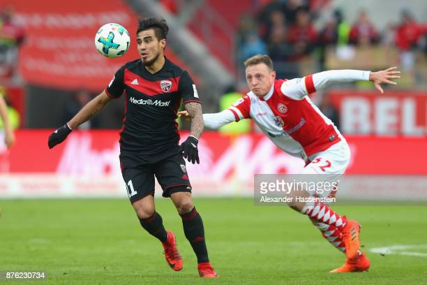 Dario Lezcano of Ingolstadt battles for the ball with Robin Bormuth of Duesseldorf during the Second Bundesliga match between FC Ingolstadt 04 and...