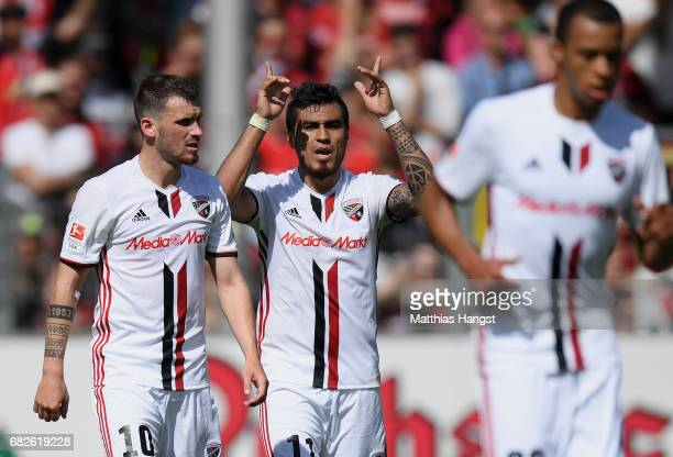 Dario Lezcano of Ingolstadt celebrates with his teammates after scoring his team's first goal during the Bundesliga match between SC Freiburg and FC...