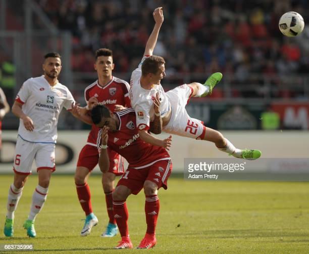 Dario Lezcano of Ingolstadt is challenged by Niko Bungert of Mainz during the Bundesliga match between FC Ingolstadt 04 and 1 FSV Mainz 05 at Audi...