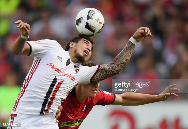 Dario Lezcano of Ingolstadt jumps for a header with MarcOliver Kempf of Freiburg during the Bundesliga match between SC Freiburg and FC Ingolstadt 04...