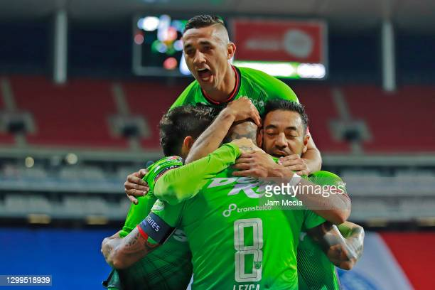 Dario Lezcano of Juarez celebrates with teammates after scoring the first goal of his team during the 4th round match between Chivas and FC Juarez as...