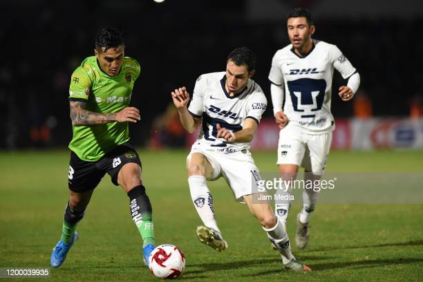 Dario Lezcano of Juarez fights for the ball with Manuel Mayorga of Pumas during the 2nd round match between FC Juarez and Pumas UNAM as part of the...