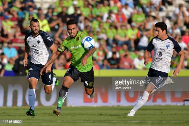 Dario Lezcano of Juarez fights for the ball with Nicolas Sanchez and Stefan Medina of Monterrey during the 8th round match between FC Juarez and...